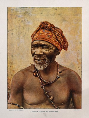 view A South African medicine man or shaman. Colour process print after a photograph by G.W. Wilson.