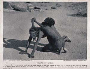 view Two Australian aborigines performing a ceremony with a magical stick to make another person ill. Halftone.