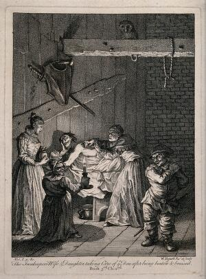 view An innkeeper's wife and daughter taking care of Don Quixote's wounds and injuries after being beaten. Engraving after W. Hogarth after M. de Cervantes Saavedra.