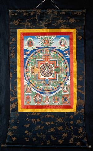 view Mandala with the eight-handed Uṣṇīṣavijayā as a Buddhist deity of long life. Distemper painting by a Tibetan painter.