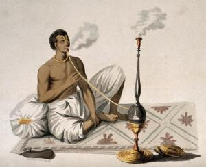 view An Indian man smoking a nariel, or cocoa nut hooka. Coloured stipple and line etching, c. 1804, after F. Solvyns.