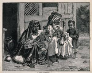 view An old Afghan man sits with a woman and child on the ground smoking a hooka. Wood-engraving after F. Dadd.