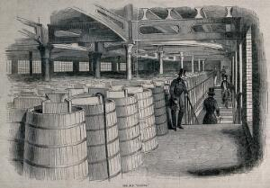 view Barclay and Perkins brewery, Southwark: visitors in a storeroom full of casks of ale. Wood-engraving, 1847.