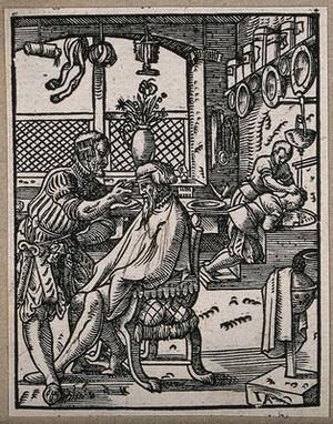 view A barber cutting a man's hair. Woodcut by Jost Amman.
