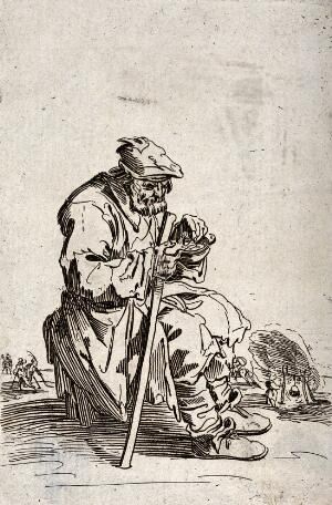 view A bearded beggar sitting on a stone eats from a bowl while he holds his staff in his right hand. Etching with engraving possibly after J. Callot.