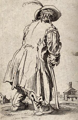 view A beggar dressed in rags limping with the aid of a staff towards a village. Etching possibly after J. Callot.