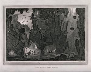 view An iron mine and miners working. Etching by J. Heath, 1813, after C.M. Metz.