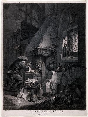 view An alchemist stoking a furnace in a dimly lit room, as daylight shines through a window. Engraving by P-F. Basan after T. Wyck.