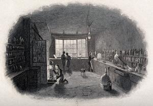 view A chemical laboratory with four chemists; one looks into a furnace. Engraving.