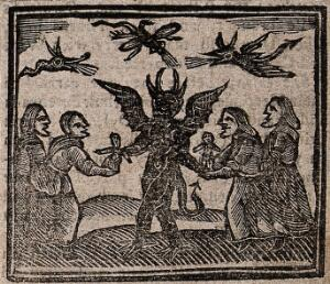 view Witchcraft: witches giving babies to the devil. Woodcut, 1720.