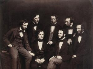 view Residents at the Old Royal Infirmary, Edinburgh, summer 1854: clockwise from left, John Beddoe (seated left), John Kirk (back row), George Hogarth Pringle (back row), Patrick Heron Watson (back row), Alexander Struthers (seated right), David Christison (seated in front, right), Joseph Lister (seated in front, left). Photograph.