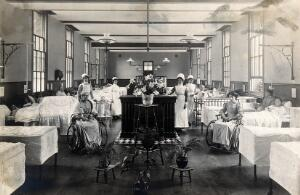 view St Marylebone Infirmary, London: ward with nurses and patients. Photograph, 1910.