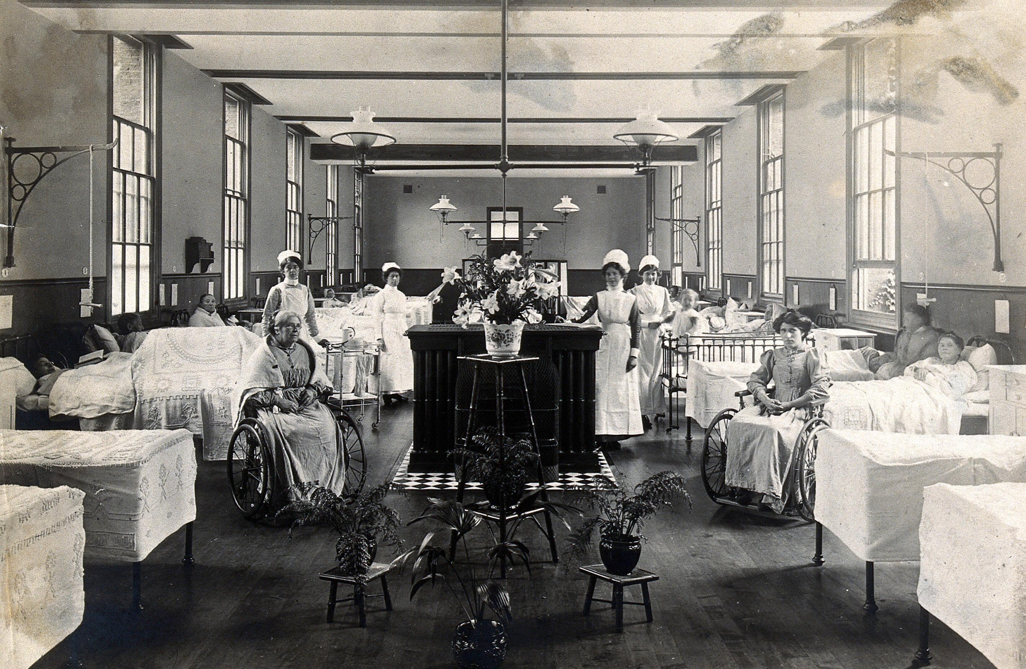 Photograph of nurses and patients on a ward in St Marylebone Infirmary, taken in 1910