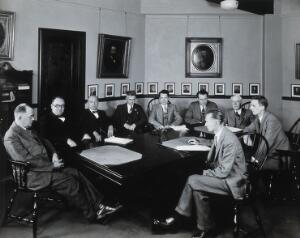 view Philadelphia College of Pharmacy and Science: men in a conference room. Photograph, c. 1933.