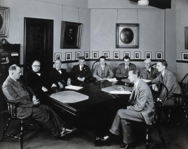 Philadelphia College of Pharmacy and Science: men in a conference room. Photograph, c. 1933.