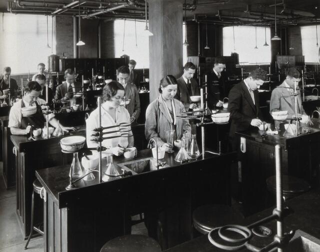 Philadelphia College of Pharmacy and Science: students being taught in a laboratory-style classroom. Photograph, c. 1933.