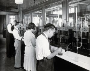 view Philadelphia College of Pharmacy and Science: students in a laboratory. Photograph, c. 1933.
