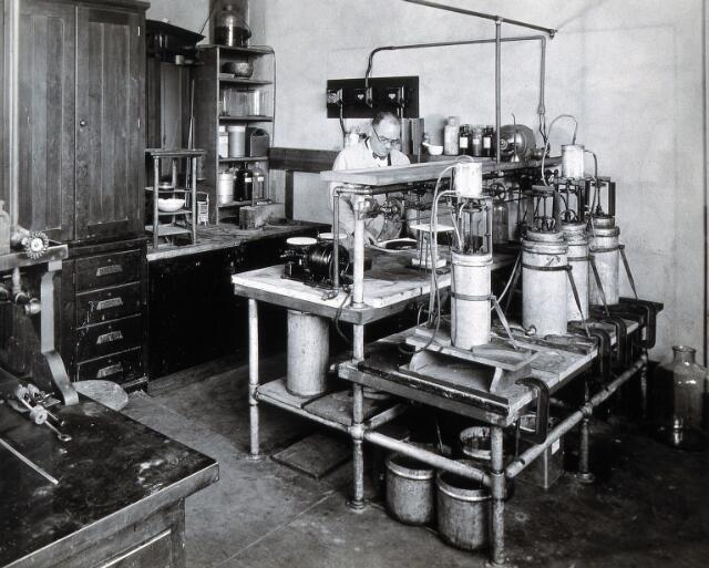 Philadelphia College of Pharmacy and Science: man with refrigeration equipment in a lab. Photograph, c. 1933.