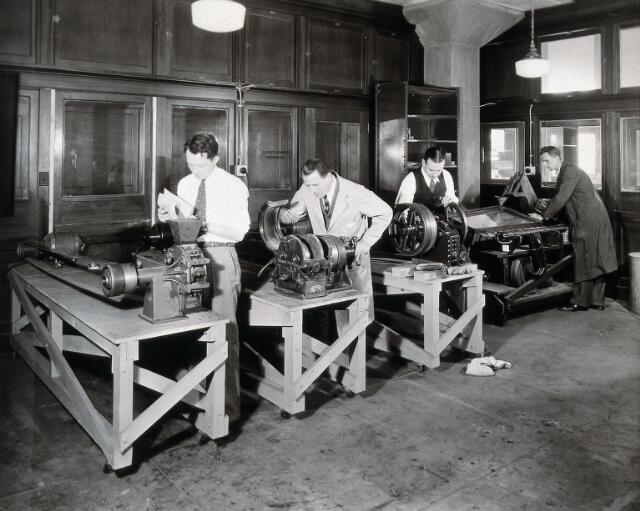 Philadelphia College of Pharmacy and Science: men using milling machines in a lab. Photograph, c. 1933.