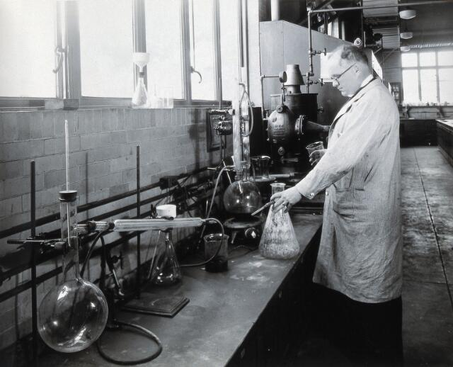 Philadelphia College of Pharmacy and Science: man in a lab. Photograph, c. 1933.