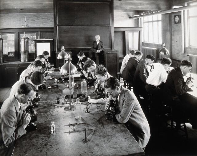 Philadelphia College of Pharmacy and Science: students looking through microscopes in a laboratory. Photograph, c. 1933.