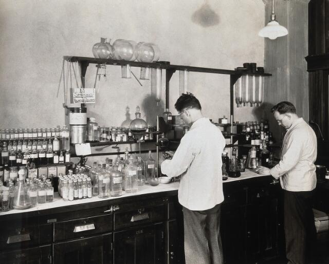 Philadelphia College of Pharmacy and Science: two men working in a laboratory. Photograph, c. 1933.