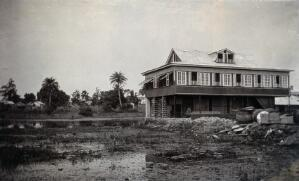 view Wooden building on swampland in Bonthe, Sierre Leone. Photograph, c. 1911.