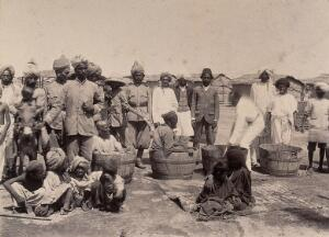 view Disinfecting sufferers of the plague in wooden tubs, Karachi, India. Photograph, 1897.