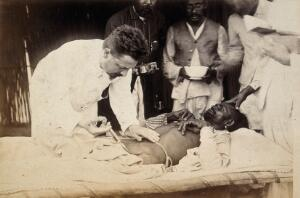 view Man being injected by doctor, during the outbreak of bubonic plague in Karachi, India. Photograph, 1897.