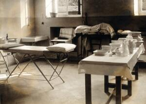 view Military Hospital V.R. 76, Ris-Orangis, France: room for dressing wounds. Photograph, 1916.