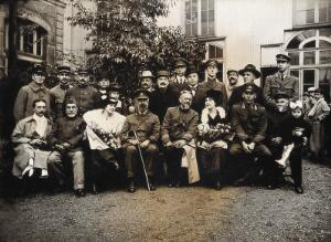 view Military Hospital V.R. 76, Ris-Orangis, France: group of people in military and civilian dress. Photograph, 1916.