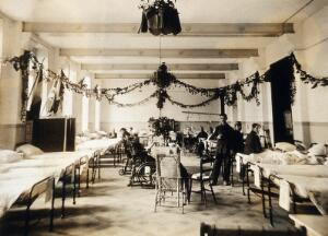 view Military Hospital V.R. 76, Ris-Orangis, France: a ward, decorated, possibly for Christmas. Photograph, 1916.
