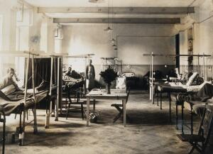 view Military Hospital V.R. 76, Ris-Orangis, France: hospital ward with patients. Photograph, 1916.