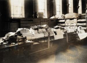 view Military Hospital V.R. 76, Ris-Orangis, France: store for linen supplied by Red Cross. Photograph, 1916.