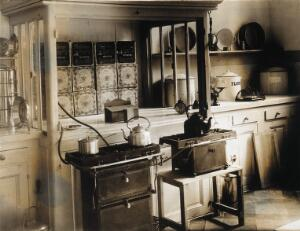 view Military Hospital V.R. 76, Ris-Orangis, France: kitchen area, with stoves and kettles. Photograph, 1916.