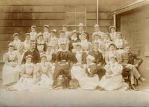 view The Royal United Hospital, Bath: hospital staff (with a dog): group portrait. Photograph, ca. 1870.