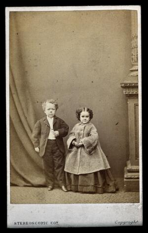 """view Two dwarfs: Minnie Warren and Commodore Nutt, bridesmaid and groomsman at """"Tom Thumb's"""" wedding in New York. Photograph, 10th February 1863."""