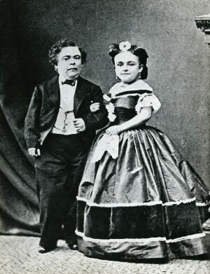 """view Two dwarfs: """"Tom Thumb"""" (Charles Sherwood Stratton) (1838-1883) and his wife Lavinia Warren Stratton (1841-1919). Photograph, c. 1865."""