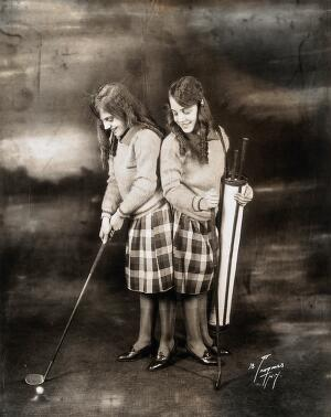 view Daisy and Violet Hilton, conjoined twins, dressed for golf. Photograph, c. 1927.