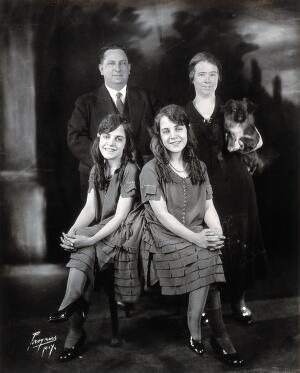 view Daisy and Violet Hilton, conjoined twins, with the Meyers, with whom they lived and who managed them. Photograph, c. 1927.