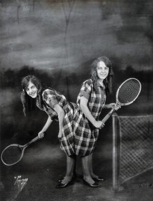 view Daisy and Violet Hilton, conjoined twins, ready for tennis. Photograph, c. 1927.