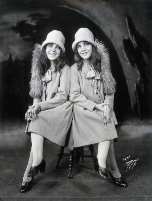 view Daisy and Violet Hilton, conjoined twins, dressed to go out. Photograph, c. 1927.