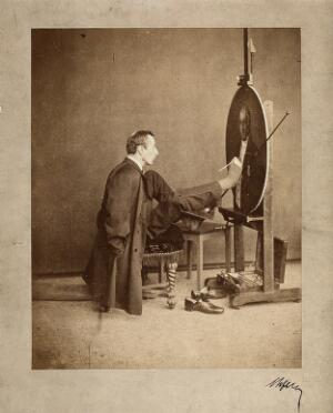 view A man painting an oval portrait using his feet. Photograph, c. 1870.
