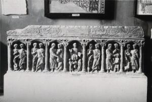view A sarcophagus depicting the miracles of Jesus Christ, displayed at the Archeological museum of Algiers, Algeria. Photograph, 1920/1950 (?), of a relief carving.