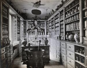 view A seventeenth-century German apothecary's shop with ornate pharmacy jars, large metal mortars and a stuffed turtle hanging from the ceiling; recreated for the German National Museum in Nürnberg. Photograph by Christof Müller.