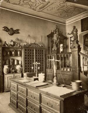 view The interior of a seventeenth-century apothecary's shop recreated for the German National Museum in Nürnberg. Photograph.