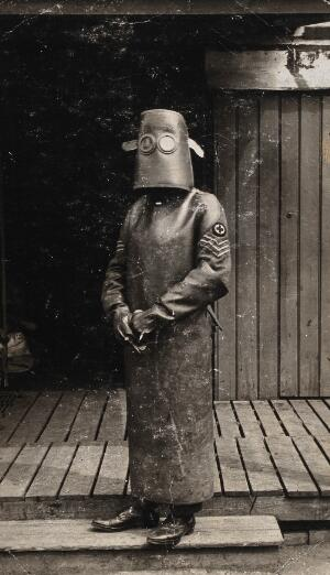 view World War One, France: a radiographer wearing protective clothing and headpiece. Photograph by H. J. Hickman, ca. 1918.
