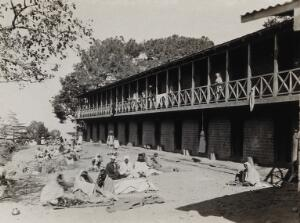 view The Pasteur Institute Hospital, Kasauli, India: Indian patients outside the accommodation building. Photograph, ca. 1910.