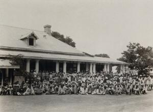 view The Pasteur Institute Hospital, Kasauli, India: Indian patients grouped outside the inoculation building. Photograph, ca. 1910.