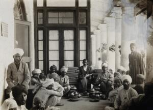view The Pasteur Institute Hospital, Kasauli, India: Indian patients receiving their allocation of blankets and cooking equipment. Photograph, ca. 1910.